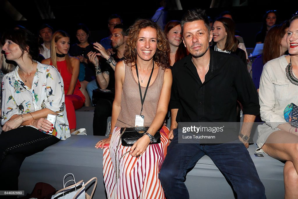Michael Beck and Ulrike Beck attend the Jeans For Refugees By Johny Dar show during the Mercedes-Benz Fashion Week Berlin Spring/Summer 2017 at Erika Hess Eisstadion on July 1, 2016 in Berlin, Germany.