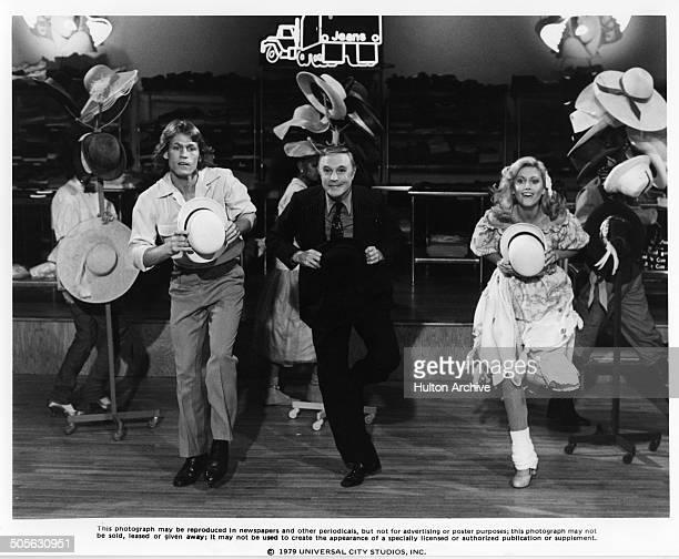 Michael Beck Gene Kelly and Olivia NewtonJohn dance in a scene in the Universal Studio movie 'Xanadu' circa 1979