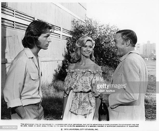 Michael Beck Olivia NewtonJohn and Gene Kelly talk in a scene in the Universal Studio movie 'Xanadu' circa 1979