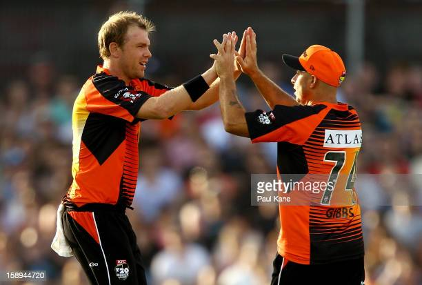 Michael Beer and Herschelle Gibbs of the Scorchers celebrate dismissing Simon Keen of the Thunder during the Big Bash League match between the Perth...