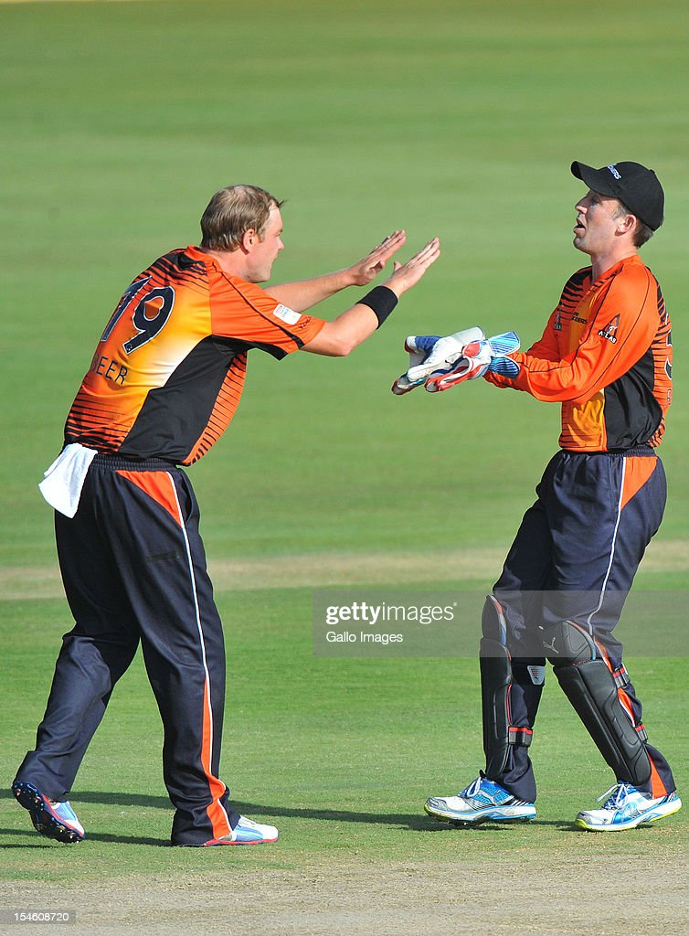 Michael Beer (L) of Perth celebrates the wicket of Gareth Hopkins of Aces with his team-mate Luke Ronchi during the Karbonn Smart CLT20 match between Auckland Aces and Perth Scorchers at SuperSport Park on October 23, 2012 in Pretoria, South Africa.