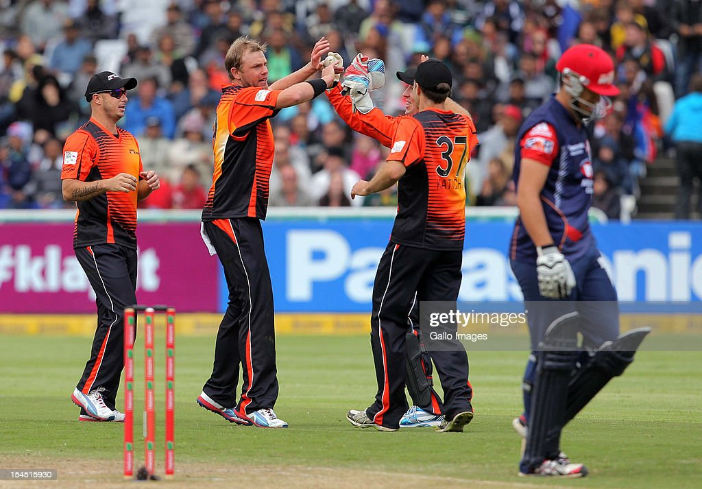 <a gi-track='captionPersonalityLinkClicked' href=/galleries/search?phrase=Michael+Beer&family=editorial&specificpeople=7299641 ng-click='$event.stopPropagation()'>Michael Beer</a> of Perth Scorchers celebrates the wicket of <a gi-track='captionPersonalityLinkClicked' href=/galleries/search?phrase=Ross+Taylor&family=editorial&specificpeople=845922 ng-click='$event.stopPropagation()'>Ross Taylor</a> during the Champions league twenty20 match between Perth Scorchers and Delhi Daredevils at Sahara Park Newlands on October 21, 2012 in Cape Town, South Africa.