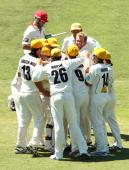 Michael Beer of the Warriors is congratulated after dismissing Dan Christian of the Redbacks during day four of the Sheffield Shield match between...