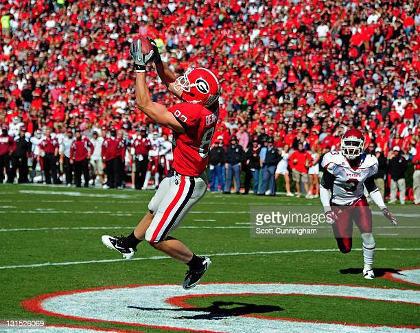 Michael Bennett of the Georgia Bulldogs makes a catch for a touchdown against the New Mexico State Aggies at Sanford Stadium on November 5 2011 in...