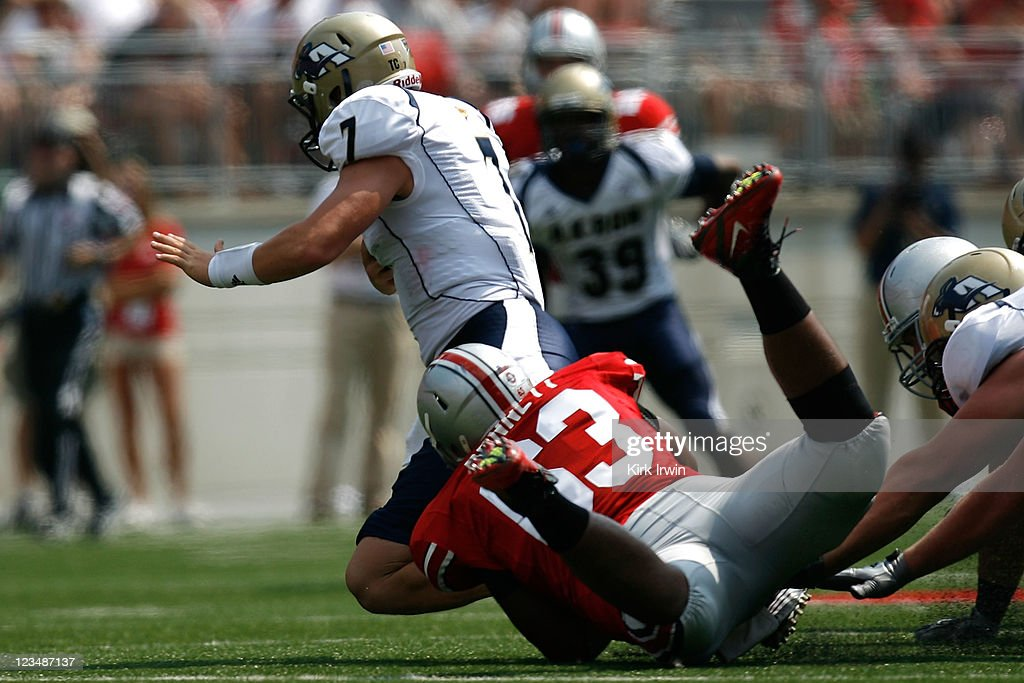Michael Bennett #63 of the Ohio State Buckeyes sacks Patrick Nicely #7 of the Akron Zips during the third quarter on September 3, 2011 at Ohio Stadium in Columbus, Ohio.