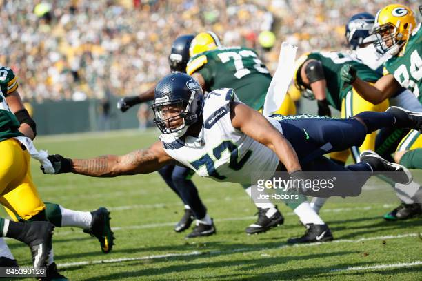 Michael Bennett of the Seattle Seahawks attempts to tackle Ty Montgomery of the Green Bay Packers during the first half at Lambeau Field on September...