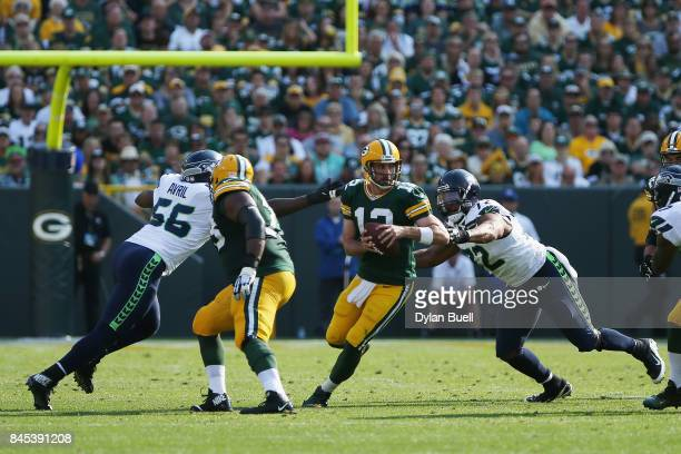 Michael Bennett of the Seattle Seahawks sacks Aaron Rodgers of the Green Bay Packers during the first half at Lambeau Field on September 10 2017 in...
