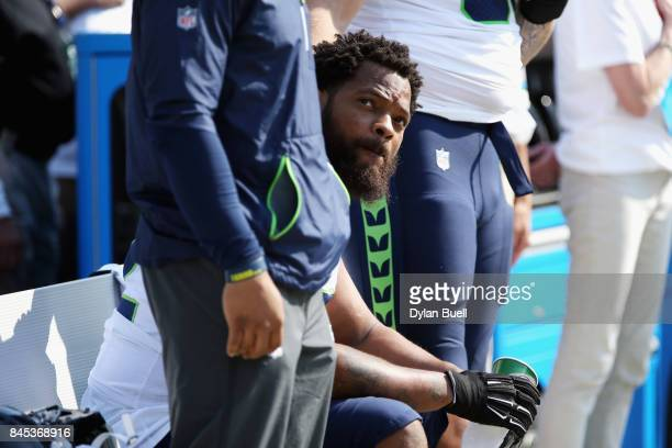 Michael Bennett of the Seattle Seahawks sits on the bench during the national anthem prior to the game against the Green Bay Packers at Lambeau Field...