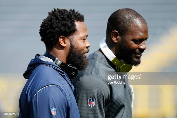 Michael Bennett of the Seattle Seahawks talks with brother Martellus Bennett of the Green Bay Packers before their game at Lambeau Field on September...