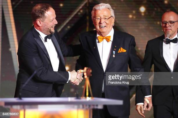 Michael Bernd Schmidt alias Smudo and Thoams Duerr alisas Thomas D of the band 'Die Fantastischen Vier' with award winner Dieter Thomas Heck during...