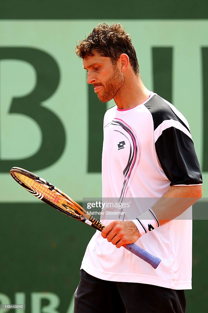 <a gi-track='captionPersonalityLinkClicked' href=/galleries/search?phrase=Michael+Berrer&family=editorial&specificpeople=780131 ng-click='$event.stopPropagation()'>Michael Berrer</a> of Germany reacts in his men's singles second round match against Nicolas Devilder of France during day four of the French Open at Roland Garros on May 30, 2012 in Paris, France.