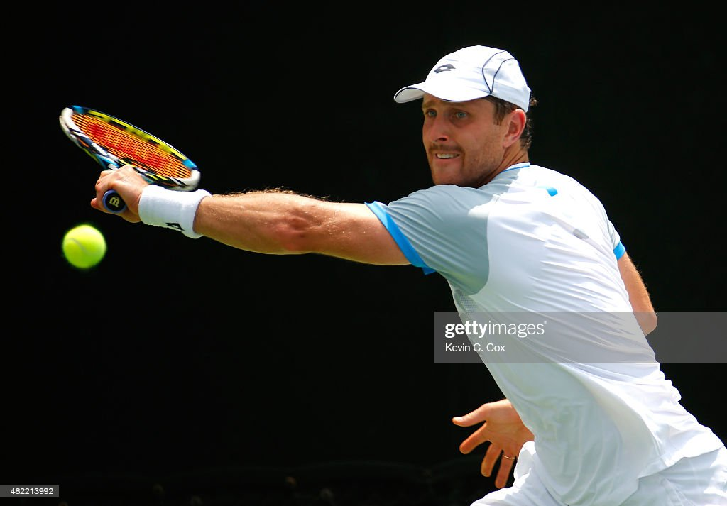 <a gi-track='captionPersonalityLinkClicked' href=/galleries/search?phrase=Michael+Berrer&family=editorial&specificpeople=780131 ng-click='$event.stopPropagation()'>Michael Berrer</a> of Germany returns a backhand to Benjamin Becker of Germany during the BB&T Atlanta Open at Atlantic Station on July 28, 2015 in Atlanta, Georgia.