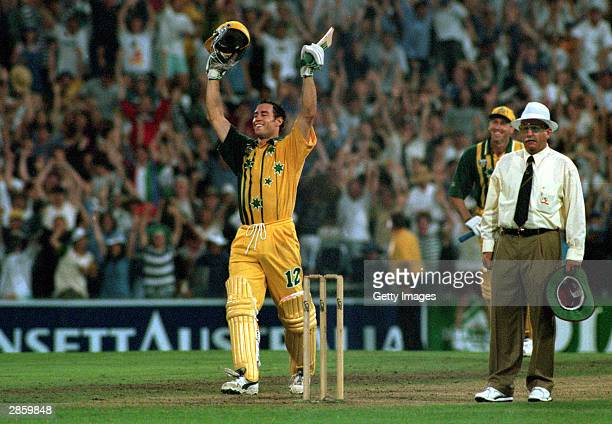 Michael Bevan of Australia celebrates after hitting a four off the last ball to win the One Day International match played between Australia and the...