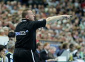 Michael Biegler head coach of Wilhelmshaven gives instructions during the Handball Bundesliga match between THW Kiel and Wilhelmshavener HV at the...