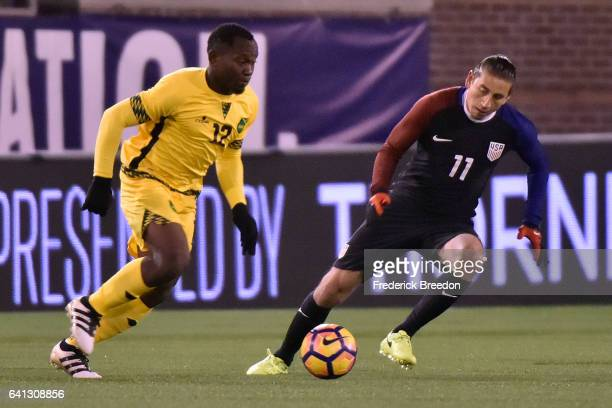 Michael Binns of Jamaica plays against Alejandro Bedoya of USA during a friendly international match at Finley Stadium on February 3 2017 in...
