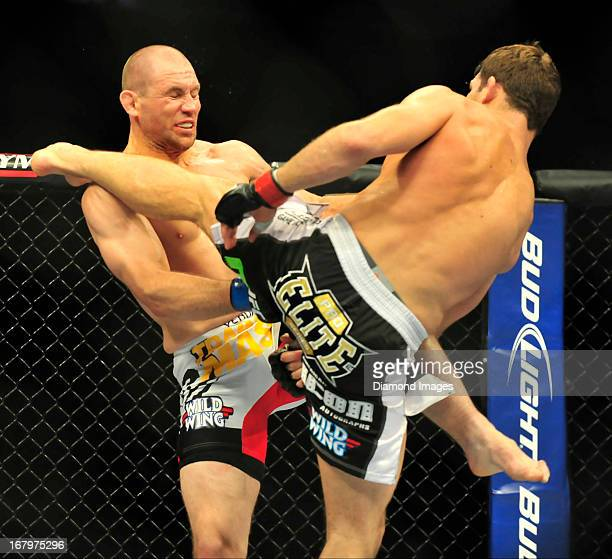 Michael Bisping and Alan Belcher kick each other during a middleweight bout during UFC 159 Jones v Sonnen at Prudential Center in Newark New Jersey
