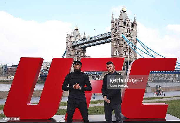 Michael Bisping and Anderson Silva pose at Tower Bridge on February 25 2016 in London England
