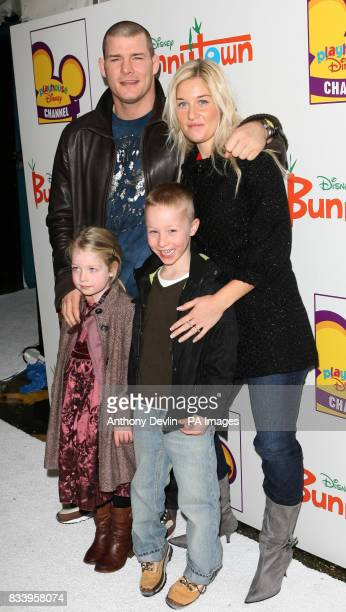 Michael Bisping and family arrive on the white carpet for Playhouse Disney's Bunnytown Christmas Winter Wonderland party in central London