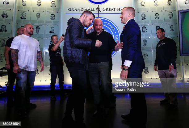 Michael Bisping and Georges StPierre face off following the UFC 217 press conference with Dana White at the Hockey Hall of Fame on October 13 2017 in...