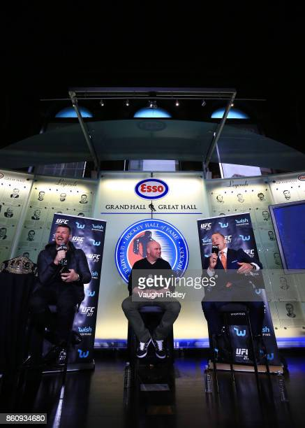 Michael Bisping and Georges StPierre speak to eachother during the UFC 217 press conference with Dana White at the Hockey Hall of Fame on October 13...