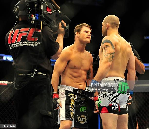 Michael Bisping andAlan Belcher face off at the center of the octagon before a middleweight bout during UFC 159 Jones v Sonnen at Prudential Center...