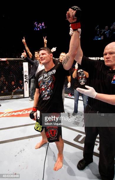 Michael Bisping celebrates after defeating Cung Le in their middleweight fight during the UFC Fight Night event at the Venetian Macau on August 23...