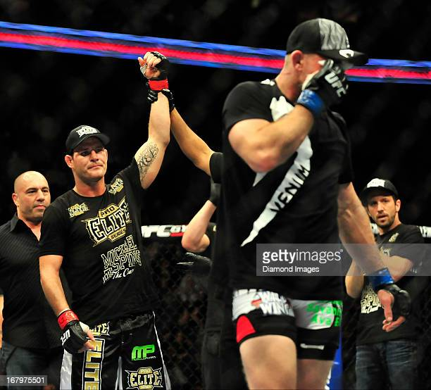 Michael Bisping looks at Alan Belcher as Belcher walks away after sustaining an eye injury after a middleweight bout during UFC 159 Jones v Sonnen at...
