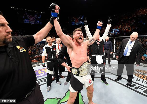 Michael Bisping of England celebrates after his first round knockout win against Luke Rockhold in their UFC middleweight championship bout during the...