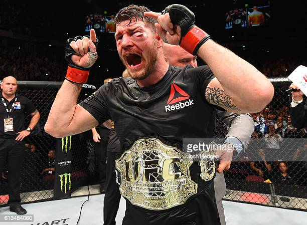 Michael Bisping of England celebrates his victory over Dan Henderson in their UFC middleweight championship bout during the UFC 204 Fight Night at...