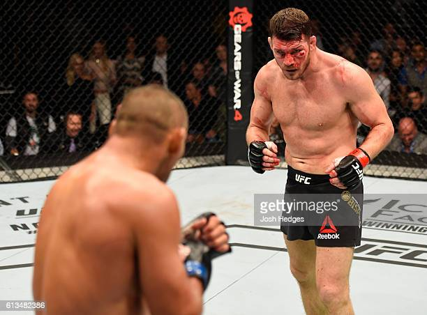 Michael Bisping of England circles Dan Henderson in their UFC middleweight championship bout during the UFC 204 Fight Night at the Manchester Evening...