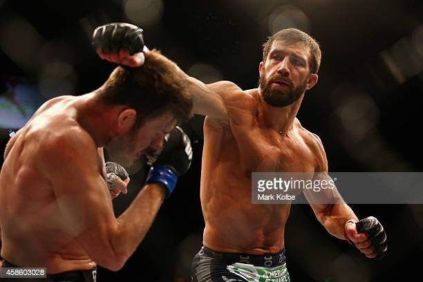 Michael Bisping of England ducks a punch from Luke Rockhold of the USA in their middleweight fight during the UFC Fight Night 55 event at Allphones...