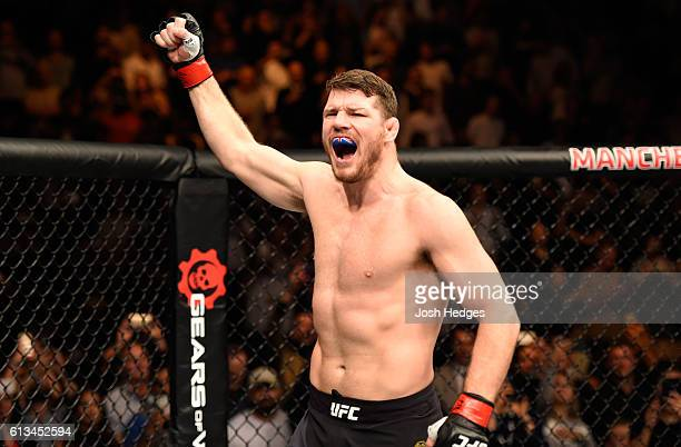 Michael Bisping of England enters the Octagon before facing Dan Henderson in their UFC middleweight championship bout during the UFC 204 Fight Night...