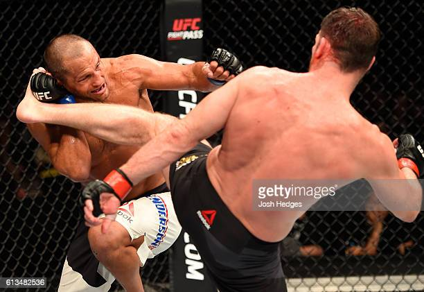 Michael Bisping of England kicks Dan Henderson in their UFC middleweight championship bout during the UFC 204 Fight Night at the Manchester Evening...