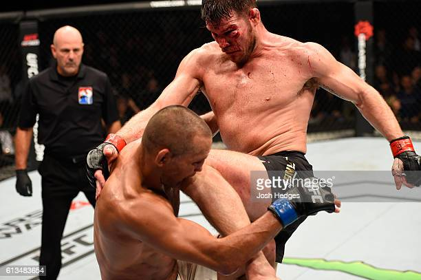 Michael Bisping of England knees Dan Henderson in their UFC middleweight championship bout during the UFC 204 Fight Night at the Manchester Evening...