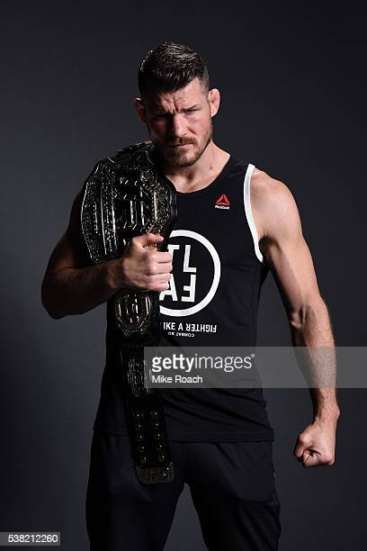 Michael Bisping of England poses backstage for a post fight portrait after defeating Luke Rockhold to attain the UFC middleweight championship title...