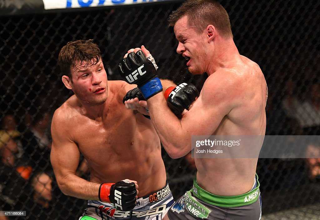 <a gi-track='captionPersonalityLinkClicked' href=/galleries/search?phrase=Michael+Bisping&family=editorial&specificpeople=4165714 ng-click='$event.stopPropagation()'>Michael Bisping</a> of England punches CB Dollaway of the United States in their middleweight bout during the UFC 186 event at the Bell Centre on April 25, 2015 in Montreal, Quebec, Canada.