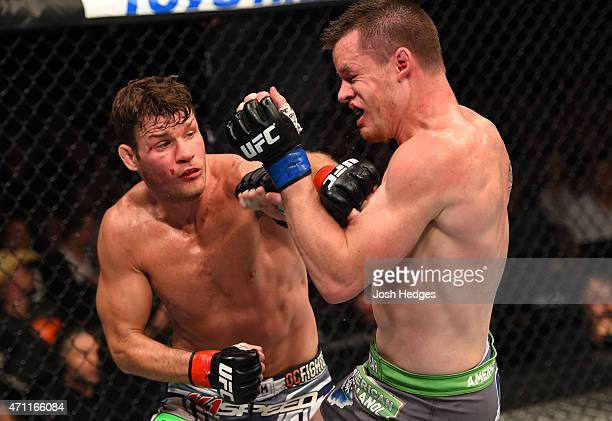 Michael Bisping of England punches CB Dollaway of the United States in their middleweight bout during the UFC 186 event at the Bell Centre on April...