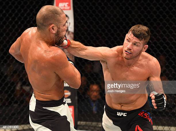 Michael Bisping of England punches Thales Leites of Brazil in their middleweight fight during the UFC Fight Night event inside the SSE Hydro on July...