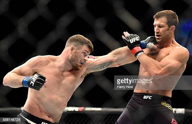 Michael Bisping of England throws a left punch at Luke Rockhold in their UFC middleweight championship bout during the UFC 199 event at The Forum on...