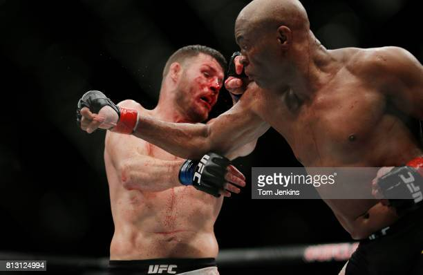 Michael Bisping of Great Britain gets punched during his middleweight fight versus Anderson Silva of Brazil at the UFC Ultimate Fighting Championship...