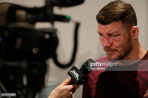 Michael Bisping of Great Britain gives an interview to an MMA website after his middleweight fight victory over Anderson Silva of Brazil at the UFC...