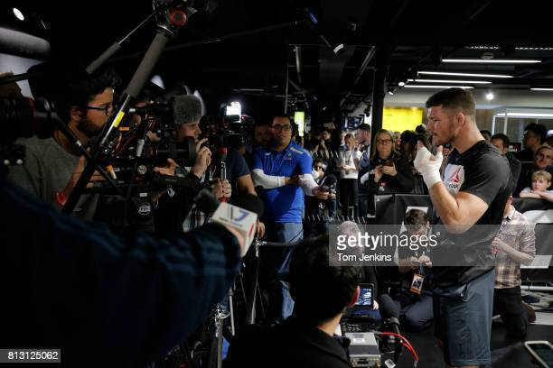 Michael Bisping of Great Britain gives media interviews during a fans invited special open training night at JD Sports Oxford Street on February 24th...