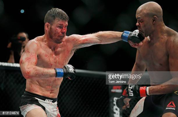 Michael Bisping of Great Britain punches during his middleweight fight versus Anderson Silva of Brazil at the UFC Ultimate Fighting Championship...