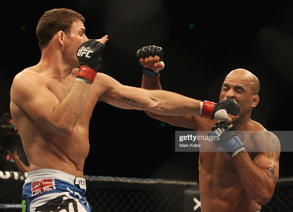 <a gi-track='captionPersonalityLinkClicked' href=/galleries/search?phrase=Michael+Bisping&family=editorial&specificpeople=4165714 ng-click='$event.stopPropagation()'>Michael Bisping</a> of Great Britain punches Jorge Rivera of the USA during their middleweight bout part of at UFC 127 at Acer Arena on February 27, 2011 in Sydney, Australia.