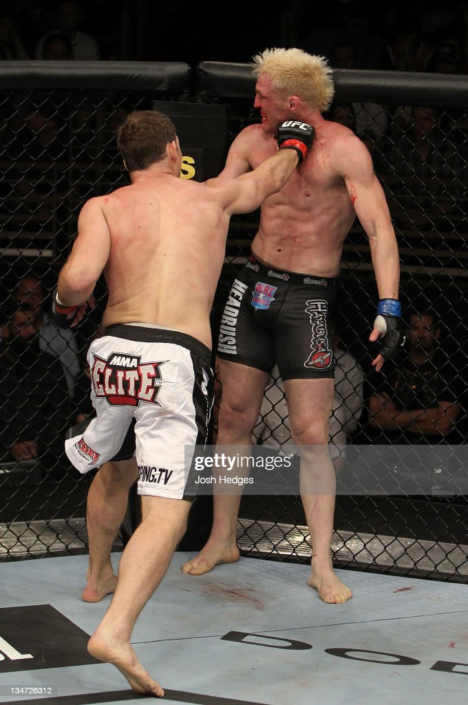 <a gi-track='captionPersonalityLinkClicked' href=/galleries/search?phrase=Michael+Bisping&family=editorial&specificpeople=4165714 ng-click='$event.stopPropagation()'>Michael Bisping</a> (L) punches Jason 'Mayhem' Miller during The Ultimate Fighter 14 Finale at the Pearl Theatre at the Palms Hotel and Casino on December 3, 2011 in Las Vegas, Nevada.
