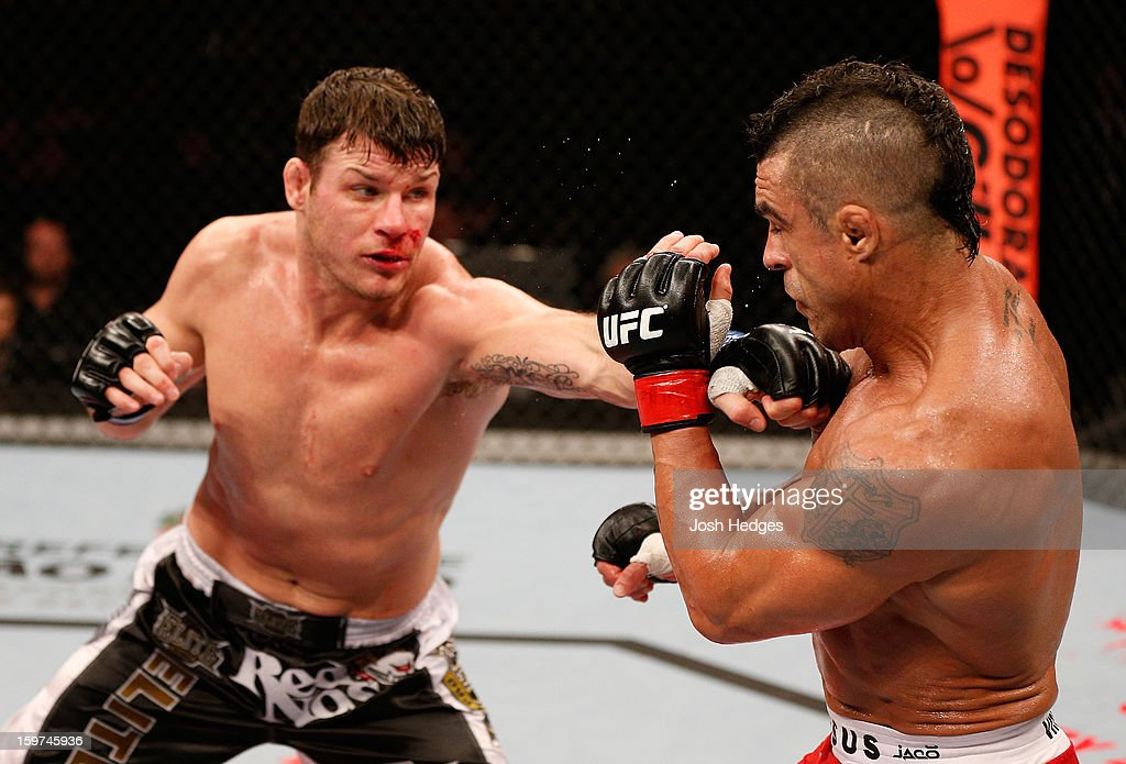 Michael Bisping punches Vitor Belfort in their middleweight fight at the UFC on FX event on January 19, 2013 at Ibirapuera Gymnasium in Sao Paulo, Brazil.