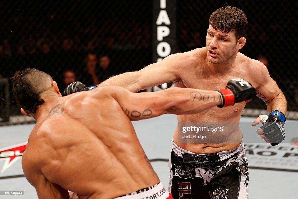 <a gi-track='captionPersonalityLinkClicked' href=/galleries/search?phrase=Michael+Bisping&family=editorial&specificpeople=4165714 ng-click='$event.stopPropagation()'>Michael Bisping</a> punches <a gi-track='captionPersonalityLinkClicked' href=/galleries/search?phrase=Vitor+Belfort&family=editorial&specificpeople=3433934 ng-click='$event.stopPropagation()'>Vitor Belfort</a> in their middleweight fight at the UFC on FX event on January 19, 2013 at Ibirapuera Gymnasium in Sao Paulo, Brazil.