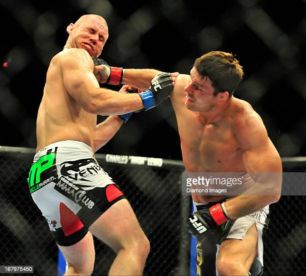Michael Bisping throws a punch to the face of Alan Belcher during a middleweight bout during UFC 159 Jones v Sonnen at Prudential Center in Newark...