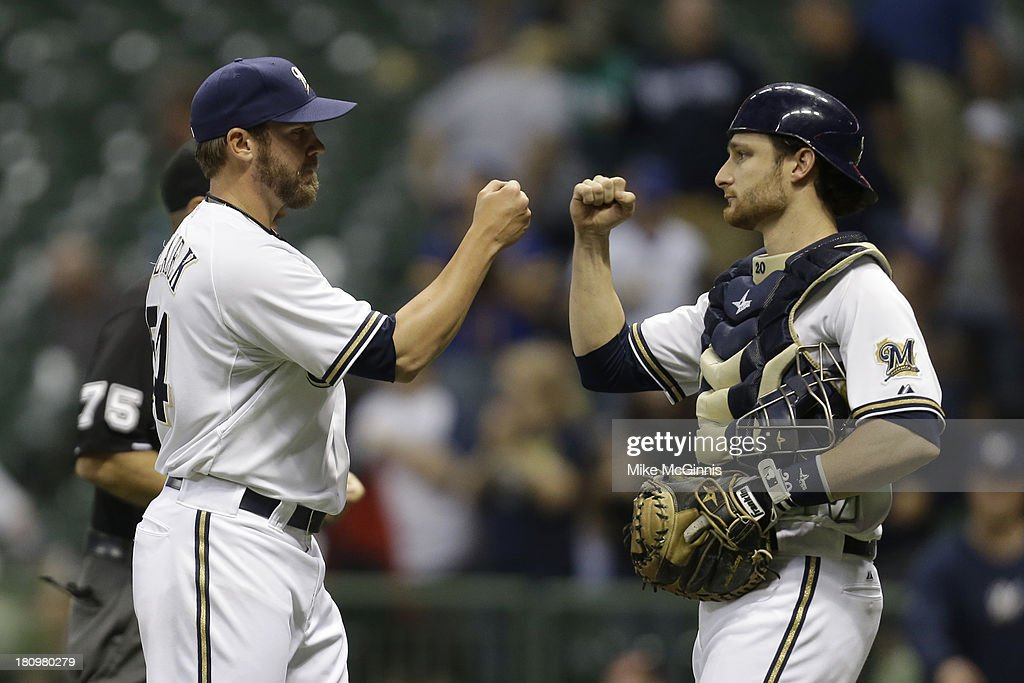 Michael Blazek #54 of the Milwaukee Brewers celebrates with <a gi-track='captionPersonalityLinkClicked' href=/galleries/search?phrase=Jonathan+Lucroy&family=editorial&specificpeople=5732413 ng-click='$event.stopPropagation()'>Jonathan Lucroy</a> #20 after the 7-0 win over the Chicago Cubs at Miller Park on September 18, 2013 in Milwaukee, Wisconsin.