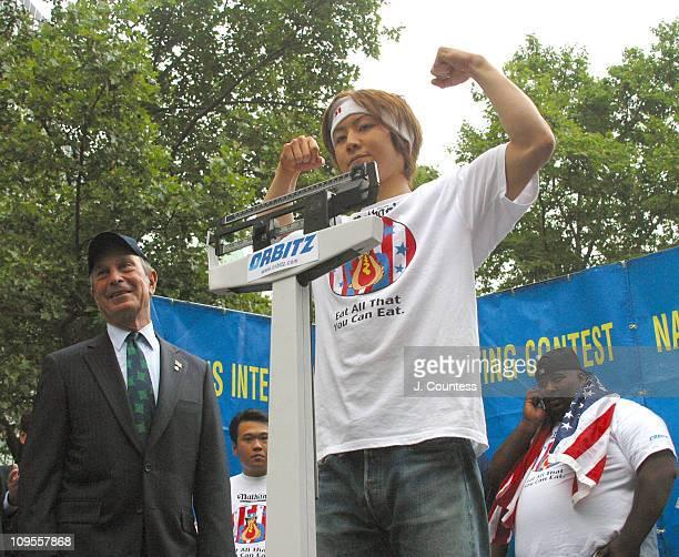 Michael Bloomberg Mayor of New York overseeing the weighin of Tekeru Kobayashi three time winner of the Nathan's Fourth of July International Hot Dog...
